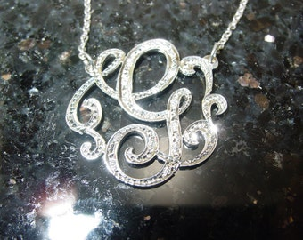 "Sterling silver  initial. 1.25"" size. with 15 cz stones  with a  chain."