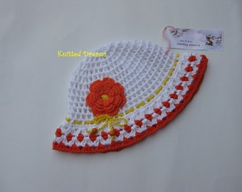 Crochet white cotton cap with large flower and cord  for girls.