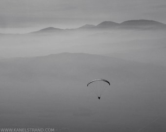 Zen art, adventure photography, paraglider in the mist, mountain view, monochrome picture, minimalist photo, 8x10