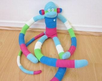 Colorblocked knee sock monkey - aqua, blue, green, magenta, and white