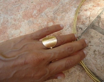 Unique gold ring with prayer on top