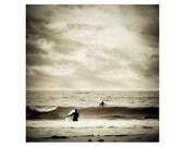 Surfer Photo. Surf. Surfing. Ocean. Waves. Sea. Clouds. Sky. Dark. Black. White. Gray. Silver. beach.