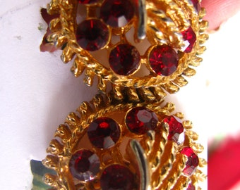 1940s/50s red stylized red glass clip earrings.  lustrous. mint condition