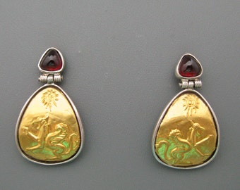 Griffins - earrings of pure gold repoussee on silver with custom cut garnets