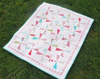 Baby quilt, crib quilt or lap quilt in red and teal floral cotton pinwheel pattern