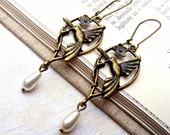 Long Bird earrings, flower bronze charm  modern boho nature eco earrings,pearl drop, dangle bird earrings vintage antique hoop