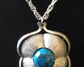 Turquoise and Silver medallion on long chain 70s