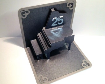 25th ANNIVeRSARY Pop Up Card 3D GRAND PIANO Home Decoration Handmade Handcut in Metallic Black and Bright Shimmery Metallic Silver.