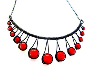 "Red ""Miracle Beads"" Black Wire Wrapped Necklace with adjustable chain."