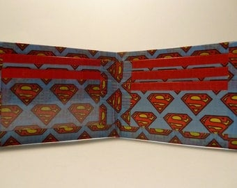 handmade duct tape wallet blue with superman logo all over it