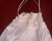 Bride  purse white satin, a cameo motif on the front