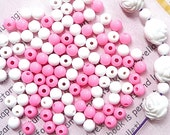 50 grams of White and Pink 6 mm round plastic beads (420 pcs)
