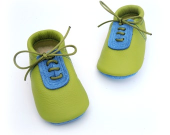 Handmade leather shoes for babies, toddlers and children.  Green and sky blue leather soft soled baby shoes.