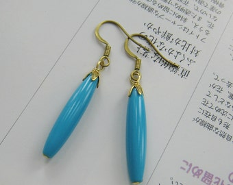 turquoise blue long rice bead earring