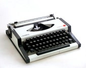 Vintage manual  typewriter - black and white  Olympia 70s - ArtmaVintage