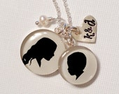 One large and One medium Child or Pet Sterling Silhouette Pendant necklace, stamped heart and pearl
