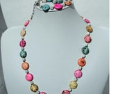 Pastel Colored Flat Round Beads with White Triangular Beads, hand knotted