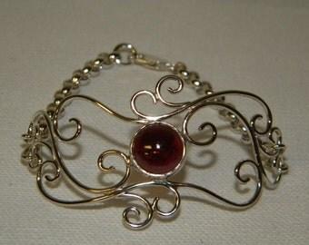 Silver Scroll work Bracelet with Garnet