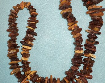 145  Golden Amber Gem Beads, Unpolished Amber stones in their original condition in wonderful warm wooden and golden color tones.