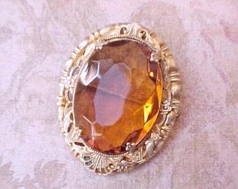 "Lovely Late Edwardian Era Brooch with Rococo Frame and Large Faceted Topaz Colored Glass ""Stone"""