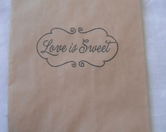 """50 Kraft """"Love is Sweet"""" stamped candy bags"""