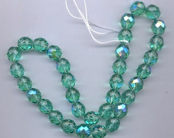 Twelve Czech firepolished glass  beads - 12 mm - unbelievably gorgeous transparent green-hued aqua AB