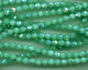 24 Czech firepolished glass  beads - 8 mm -opalescent seafoam AB