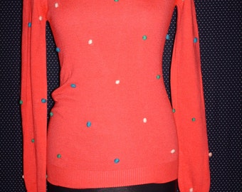 Oh-so-cute coral jumper with mini bobbles