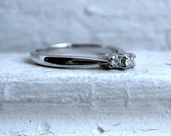 Vintage Traditional Three Stone Diamond Engagement Ring in 14K White Gold.
