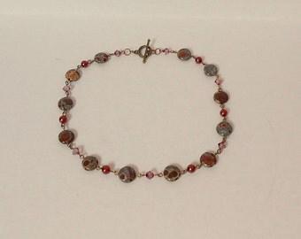 Delicate blue / brown orbicular jasper and antique pink Swarovski crystal necklace