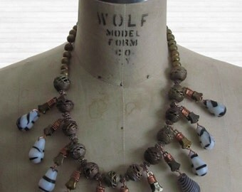 African Squash Blossom necklace made of beads from Mali, Ghana, Ethiopia and zippers
