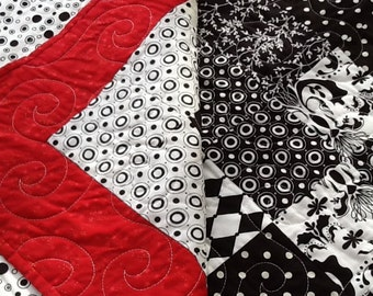 Arrangement in red and black patchwork quilt