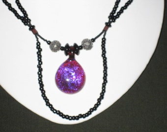 Intriquing glass duo sided tear drop  glass pendant