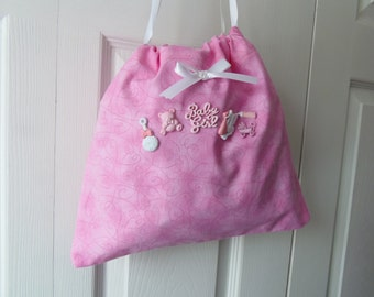 Baby Gift Bag reusable pink polka dot fabric with STORK and other charms - Can be used to store diapers or quick trip stuff