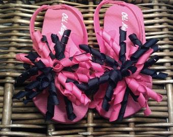 Hot Pink Flip Flops with Black & Hot Pink Korker Bows Sizes: 5 (2 left), 8 (1 left), 9 (2 left), 12/13 (4 left)
