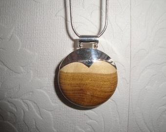Silver and Laburnumwood pendant