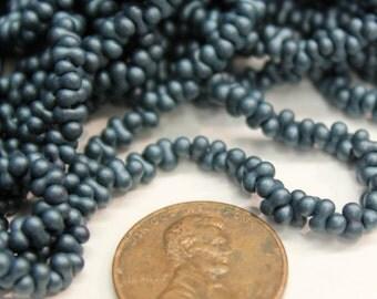 Peanut/Farfalle Seedbead, 2x4mm Shaped Seedbead,  Peanut Seedbead in Matte Teal Green, Butterfly Seedbead. Czech Seedbead