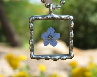Real Forget Me Not Flower Necklace in a Silver Soldered Beaded Beveled Glass Pendant