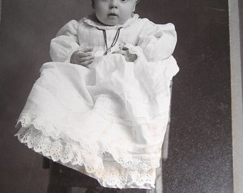 Cute Baby Cabinet Photo.... Baby  in Starched   White Dress and  Wearing a Necklace  Sitting On  a Bamboo Chair ....Vintage Baby Photos