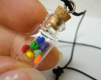 Rainbow hearts in glass bottle