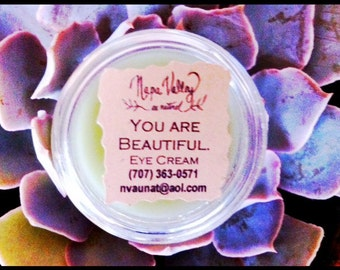 You Are Beautiful.  Blue Chamomile Eye Contour Cream in 1/4 oz clear plastic jar.