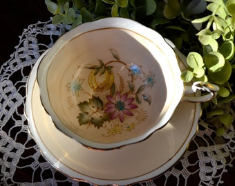 Paragon Fine Bone China Tea Cup and Saucer, Pale Peach and Multi Color Floral Cluster, Gold Gilt, England