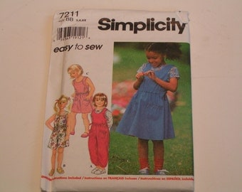 Simplicity Pattern 7211 easy to sew Child Romper in two lengths Dress Jumper and Knit Top