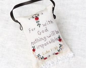 Hand embroidered sachet with red roses and vintage lace