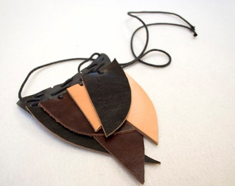 Natural recycled multicolour wings leather necklace. Black, brown and undyed leather.