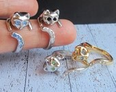 Sale -  4 Beautiful Cat rings with blue/green/black/white crystals.