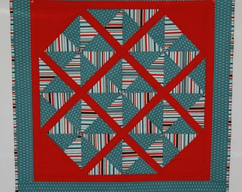 Teal and Red Pinwheel Baby Quilt