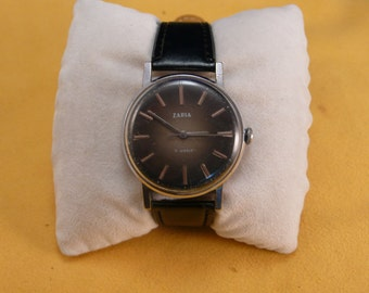 "Ussr (Soviet Union)  ""ZARJA"" 17 jewels mans  wrist watch 1970  very rare black dial VERY VERY good condition"