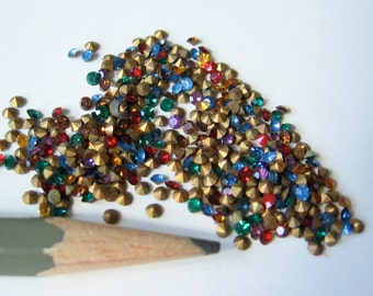 100 Swarovski assorted mixed crystal rhinestone chatons gold foil. 14pp 6ss 2mm