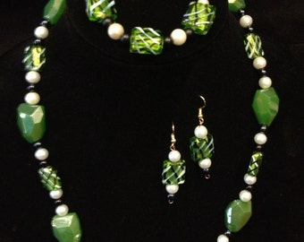 Shades of green necklace, bracelet, and earring set.